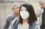 Die Frau mit Mundschutz könnte Yuriko Yushimata sein.